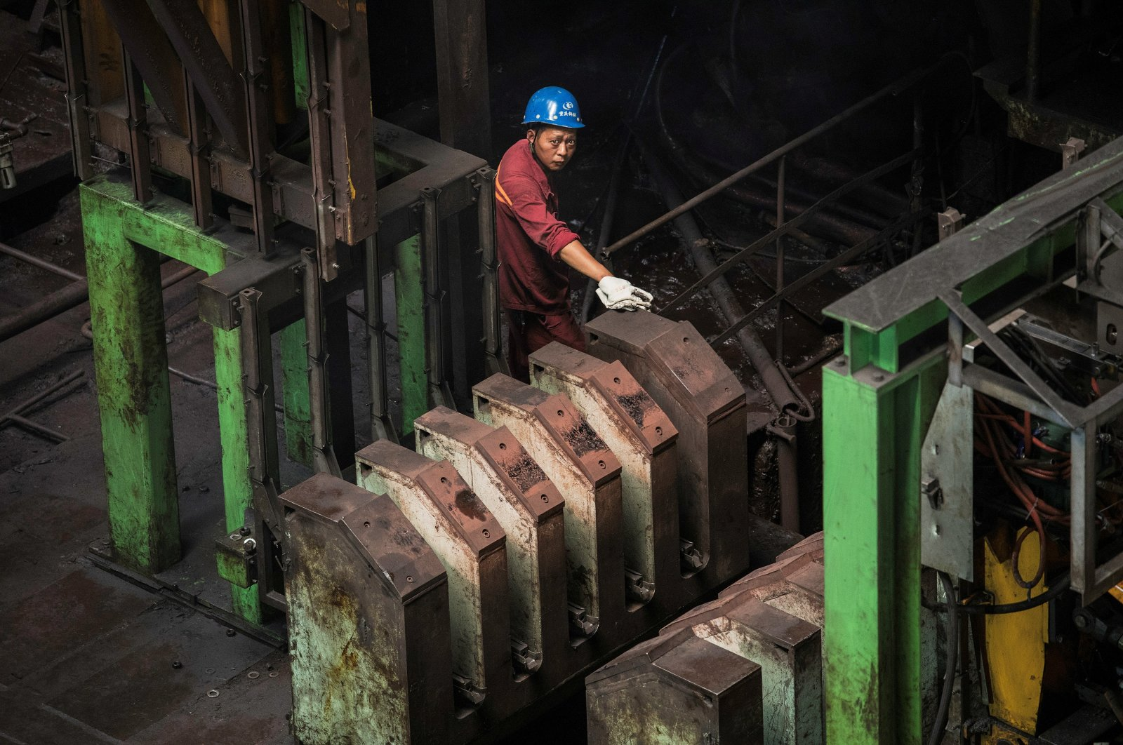 A worker is seen at a hot rolling production line at the Chongqing Iron and Steel plant in the Changshou district of Chongqing, China, Aug. 6, 2019. (Reuters Photo)