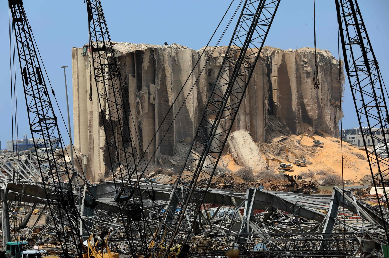Rescuers use excavators to clear the rubble at the site of damaged grain silos at the Port of Beirut, Lebanon, Aug. 12, 2020. (AFP Photo)