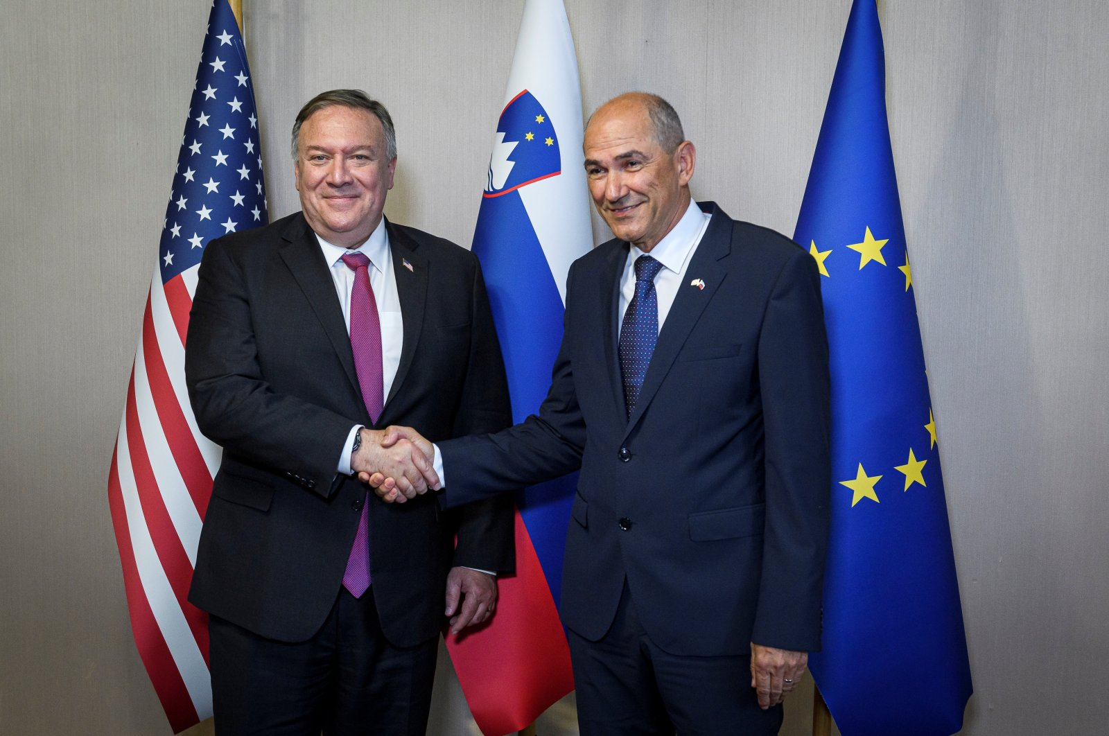 Slovenian Prime Minister Janez Jansa (R) shakes hands with U.S. Secretary of State Mike Pompeo ahead of their meeting in Bled, Slovenia, during Pompeo's four-nation visit to Central Europe, Aug. 13, 2020. (Reuters Photo)