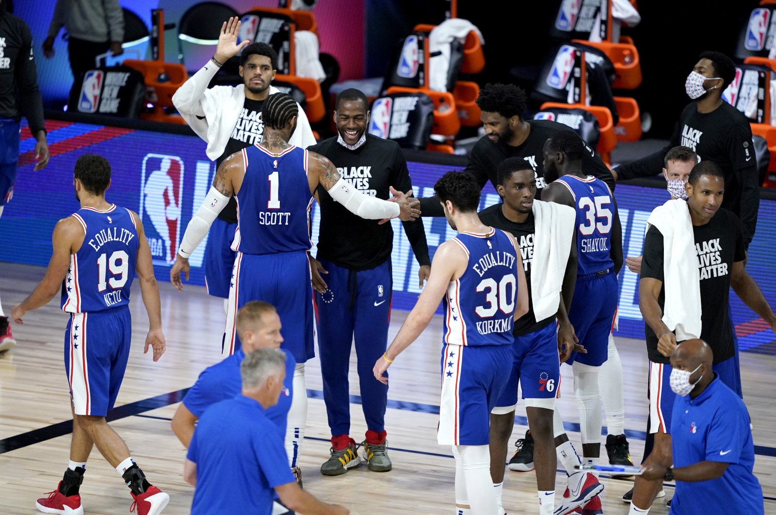 Furkan Korkmaz (30) and other Philadelphia 76ers players react during a timeout in the second half of an NBA basketball game against the Toronto Raptors in Lake Buena Vista, Florida on Aug. 12, 2020. (AP Photo)