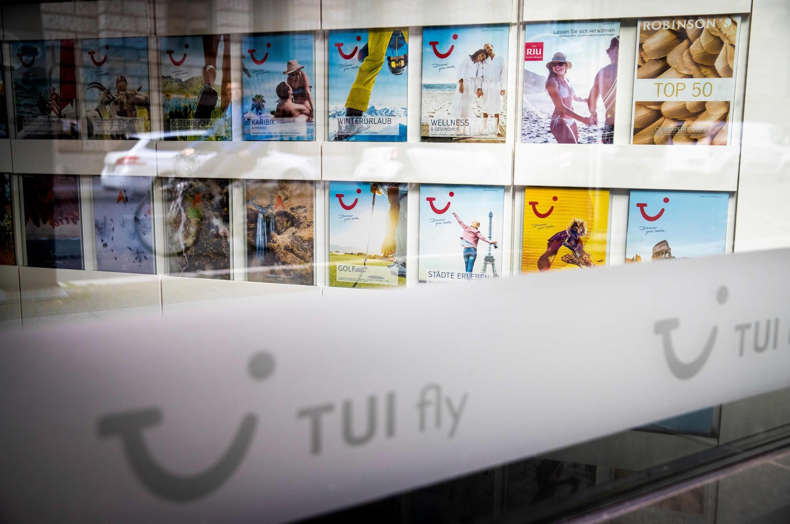 This file photo shows travel brochures inside a then closed branch of the travel firm TUI in Berlin amid the coronavirus pandemic, May 13, 2020. (AFP Photo)