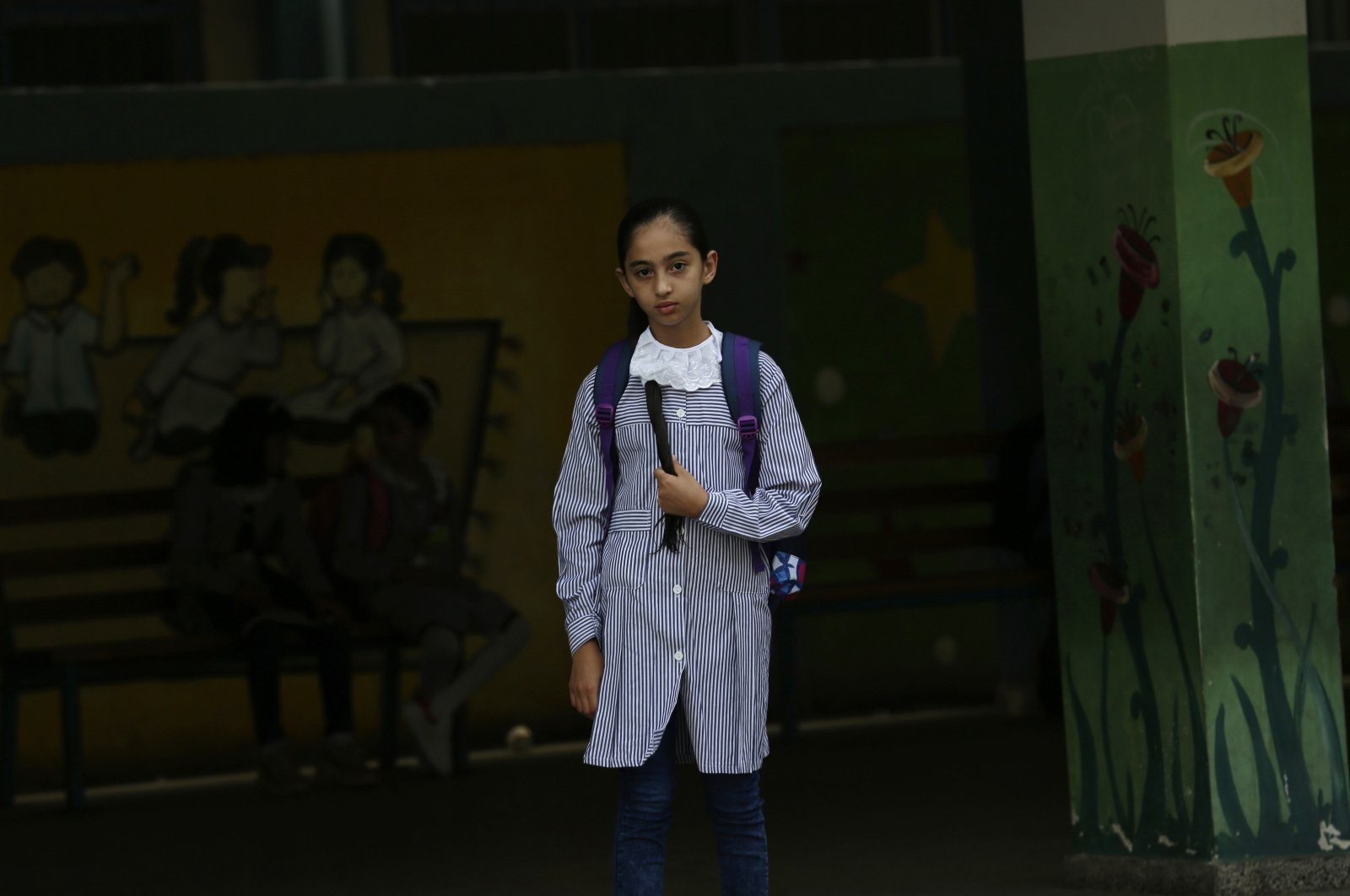 A student walks to class on the first day of the new school year at the United Nations-run elementary school at Shati refugee camp, Gaza City, Palestine, Aug. 8, 2020. (AP Photo)