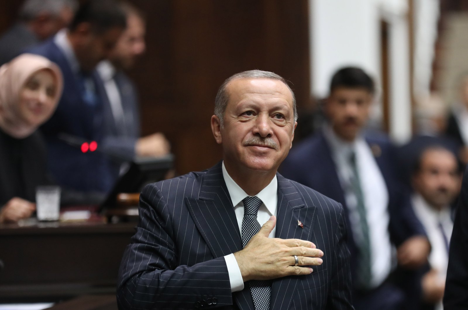 President Recep Tayyip Erdoğan salutes his party members during a parliamentary group meeting in Ankara, Oct.2, 2018. (PHOTO BY ALI EKEYILMAZ)