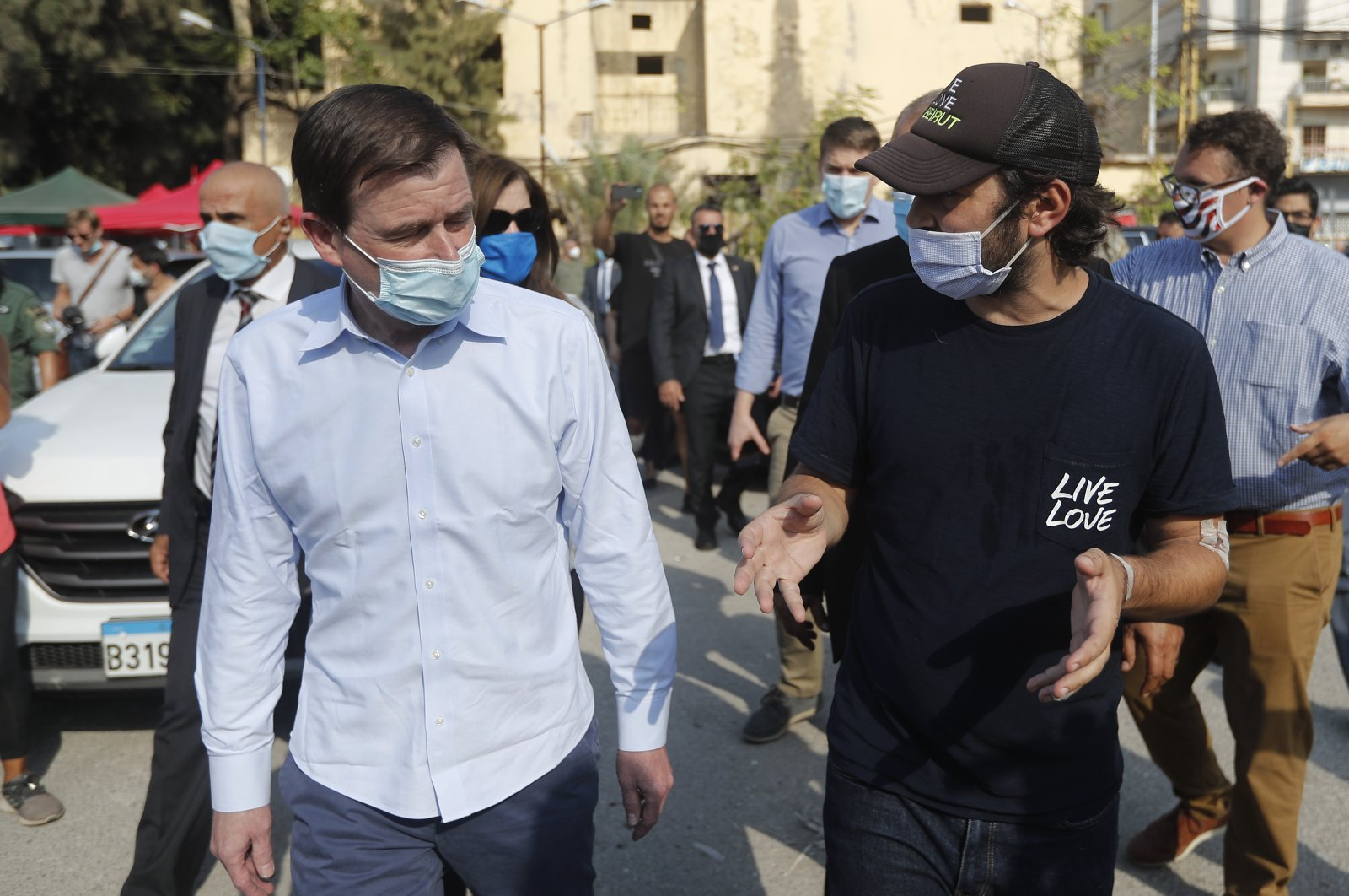 U.S. Undersecretary of State for Political Affairs David Hale, left, speaks with an NGO volunteer during his visit to the main gathering point for volunteers, near the site of last week's explosion that hit the seaport of Beirut, Lebanon, Aug. 13, 2020. (AP Photo)