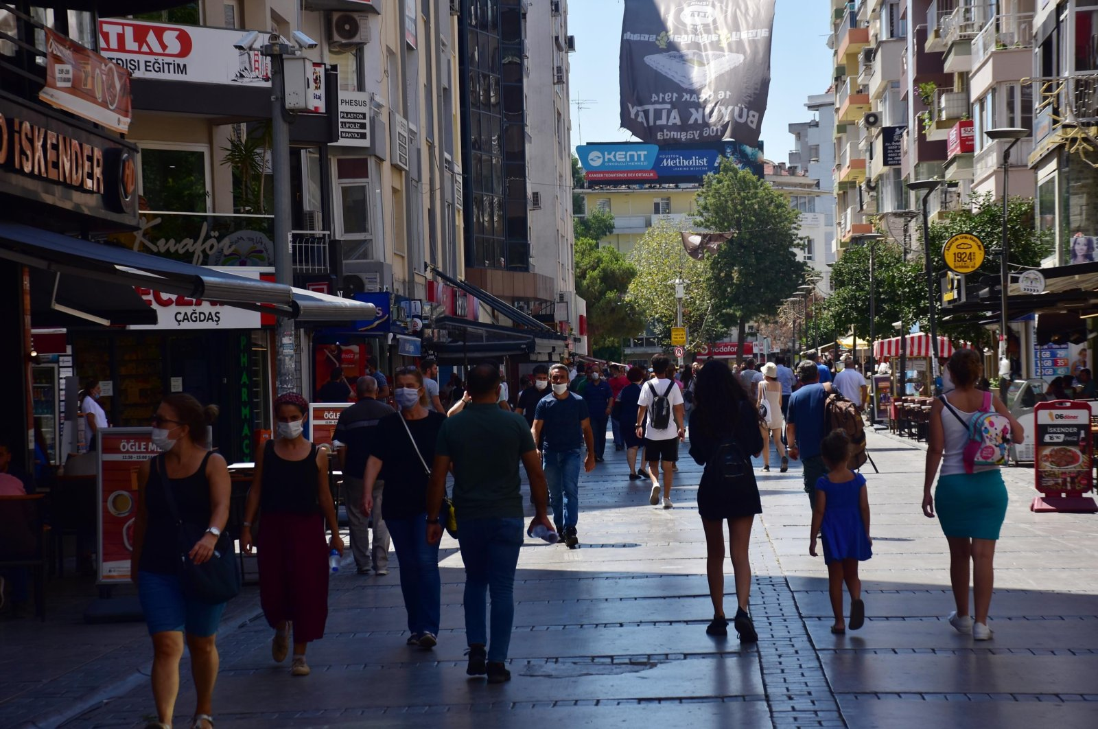 People walking down a street in Izmir, Aug 12, 2020. (DHA Photo)