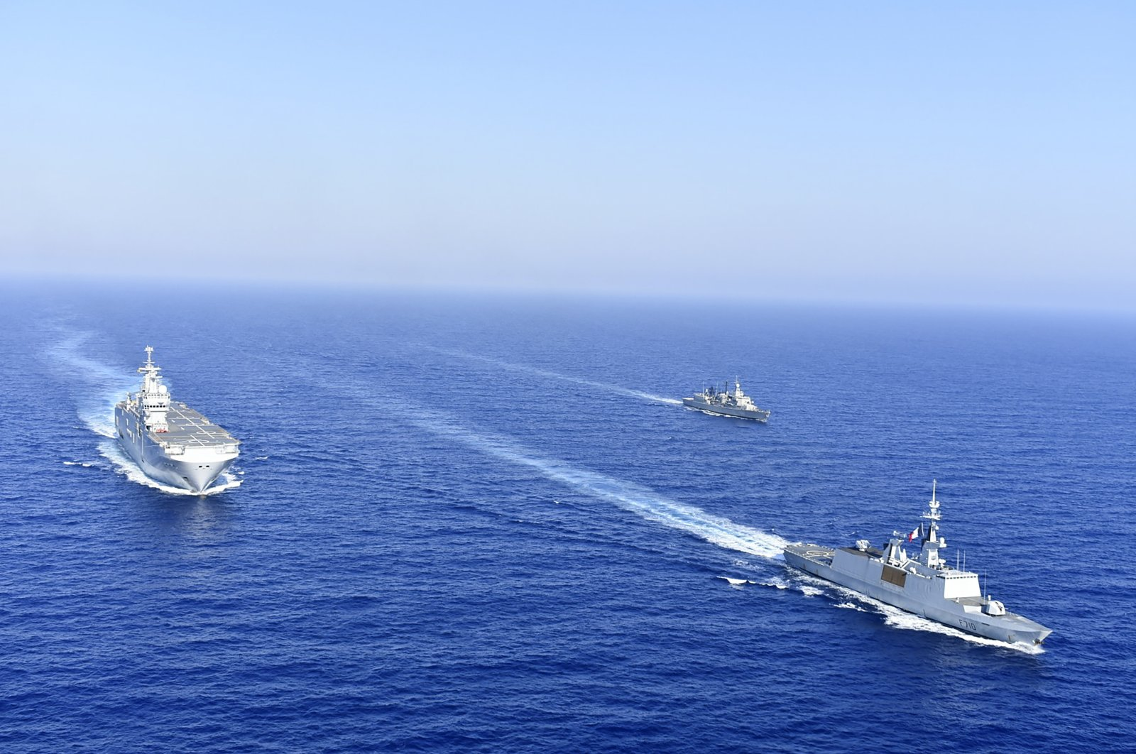 A French Tonnerre helicopter carrier is escorted by Greek and French military vessels during a maritime exercise in the Eastern Mediterranean, Aug. 13, 2020. (AP Photo)