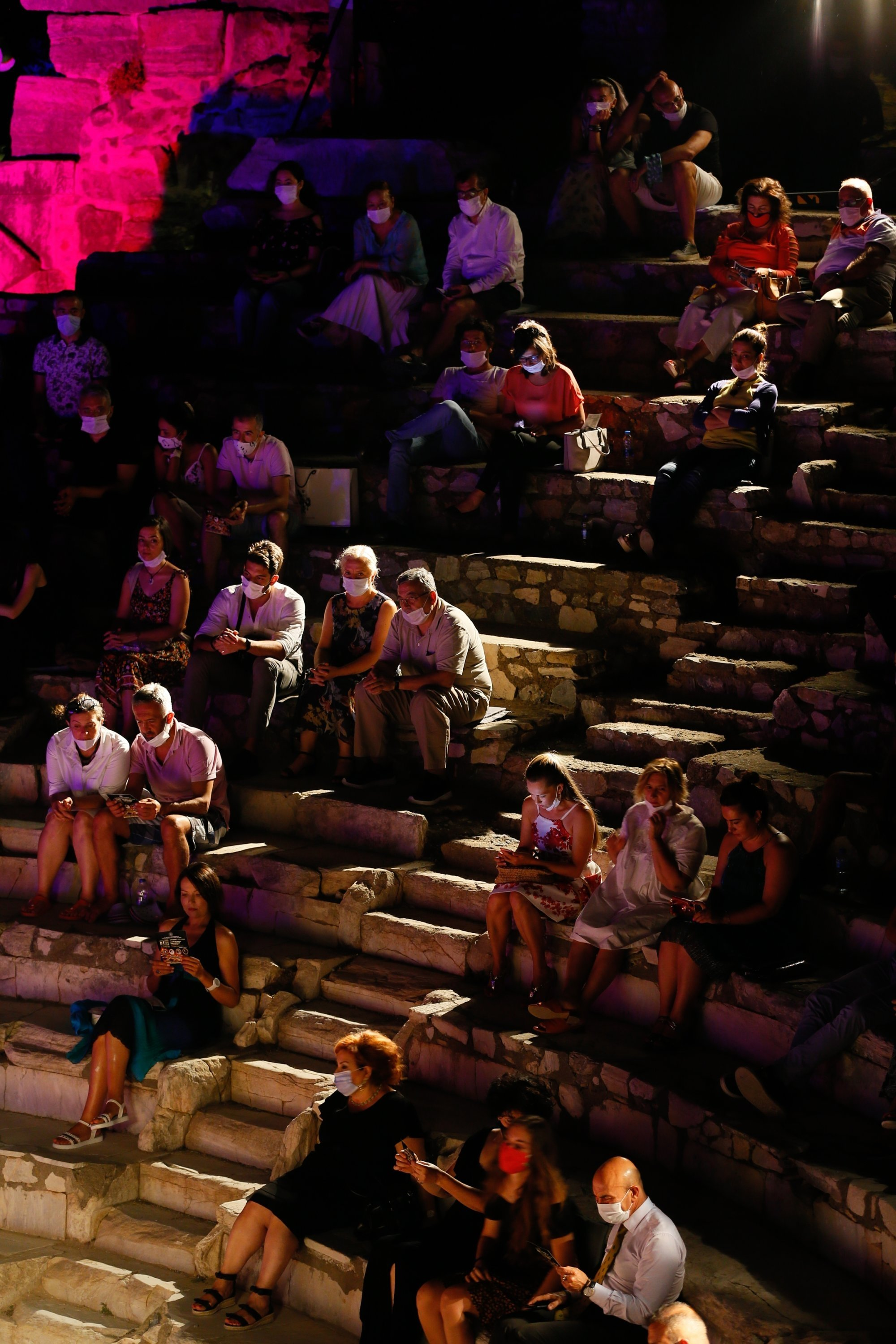 The audience sits according to social distancing and face mask rules at a concert of the International Ephesus Opera and Ballet Festival, Izmir, July 21, 2020. (AA Photo)