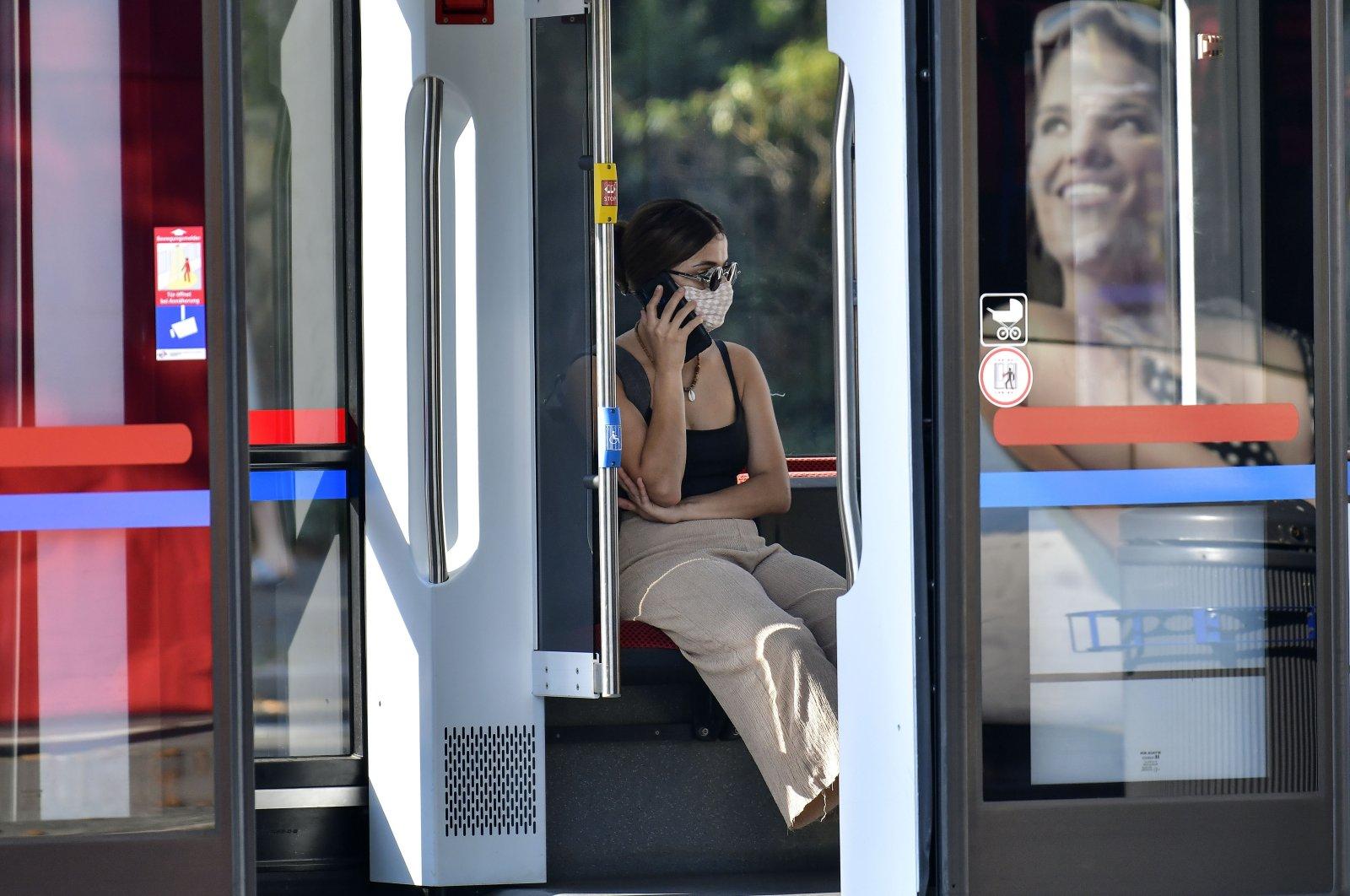 A passenger wears a face mask on a tram in Gelsenkirchen, Germany, Aug. 12, 2020. (AP Photo)