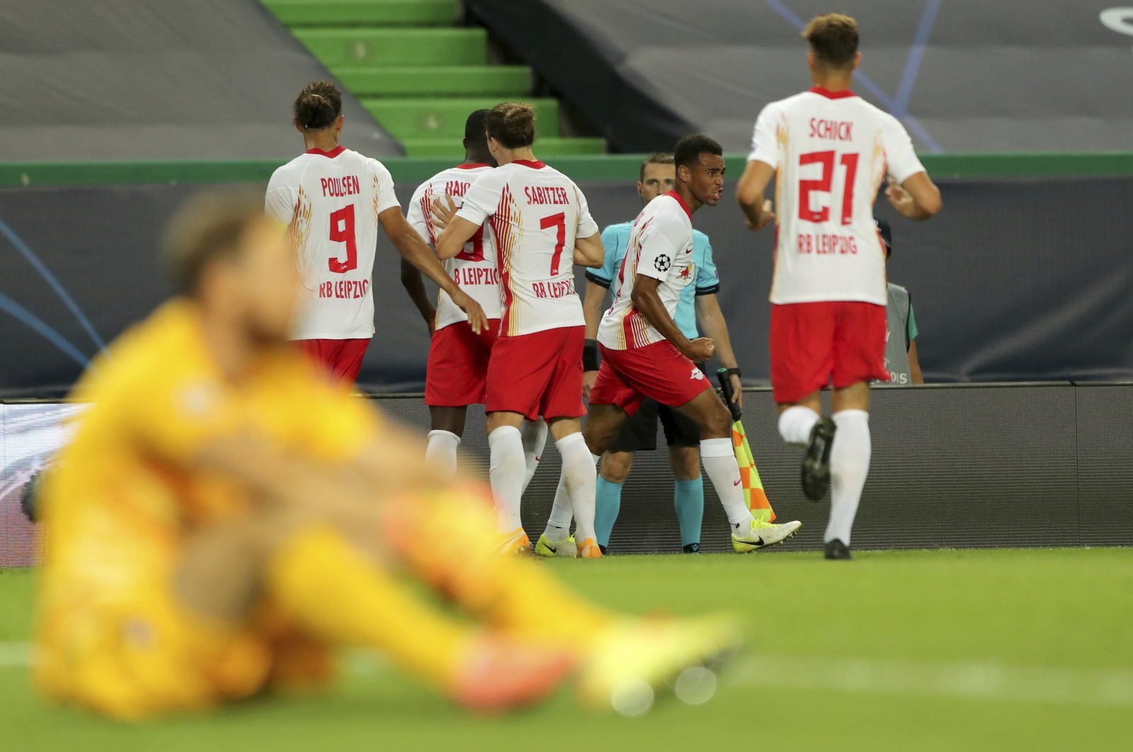 Leipzig's Tyler Adams, right, celebrates after scoring his side's second goal during the Champions League quarterfinal match between RB Leipzig and Atletico Madrid at the Jose Alvalade stadium in Lisbon, Portugal, Thursday, Aug. 13, 2020. (AP Photo)
