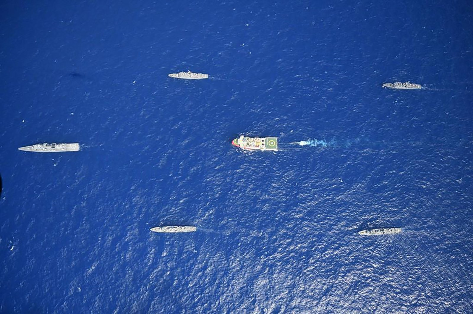 This handout photograph released by the Turkish Defence Ministry on Aug. 12, 2020, shows Turkish seismic research vessel 'Oruç Reis' (C) as it is escorted by Turkish Naval ships in the Mediterranean Sea, off Antalya on Aug. 10, 2020. (Defense Ministry Handout)