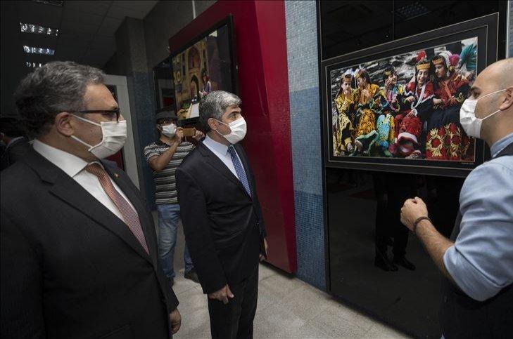 "Metin Mutanoğlu (L) and Amb. Muhammad Syrus Sajjad Qazi (M) visit the ""Colors of Pakistan Through the Eyes of Turks"" exhibition accompanied by a guide, Ankara, Turkey, Aug. 14, 2020. (AA Photo)"
