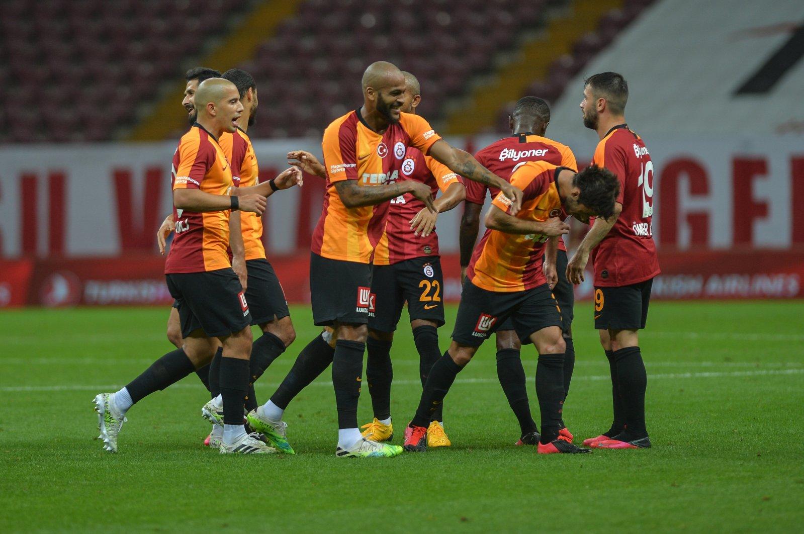 Galatasaray players celebrate a goal during a Süper Lig match in Izmir, Turkey, July 18, 2020. (DHA Photo)