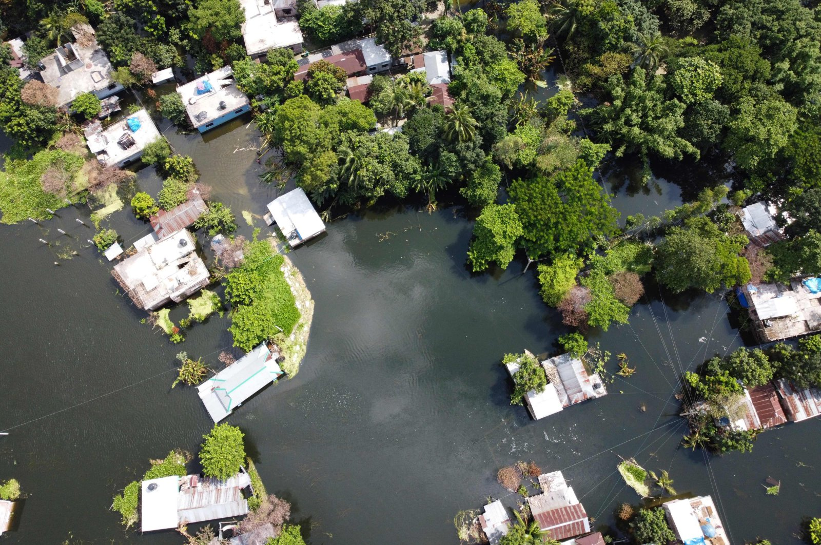 An aerial view shows a flooded residential area due to recent monsoon rainfalls, Dhamrai, Aug. 11, 2020. (AFP Photo)
