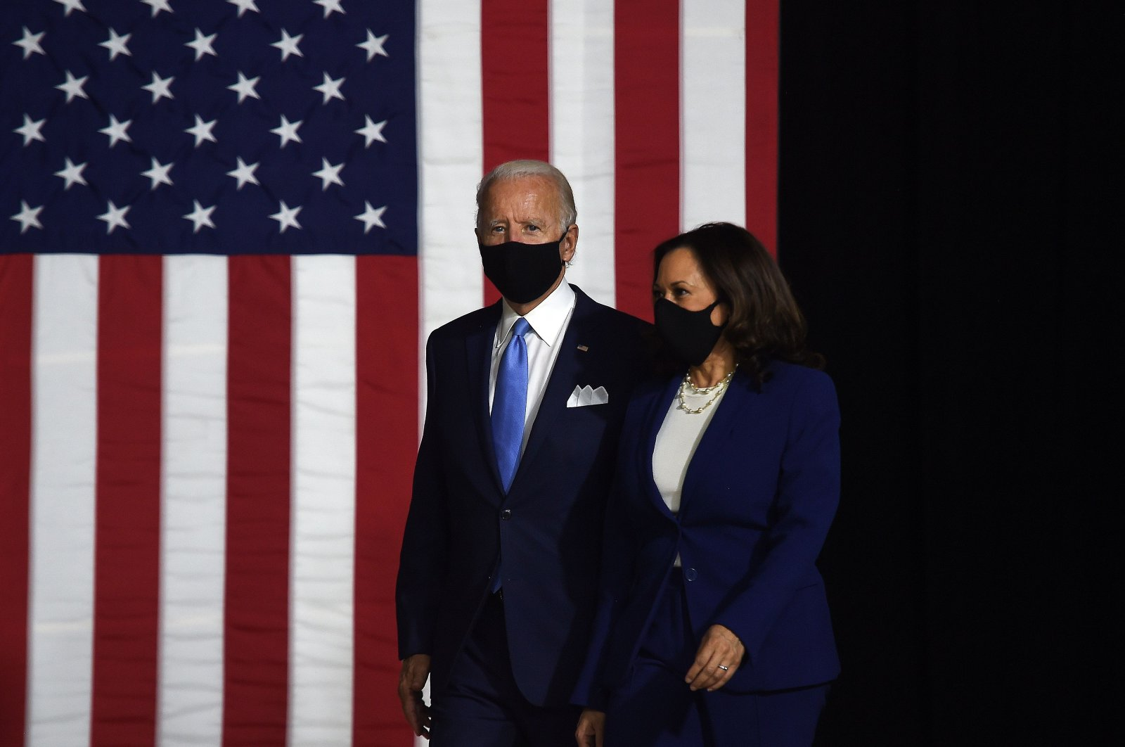 Democratic presidential nominee and former U.S. Vice President Joe Biden (L) and vice presidential running mate, U.S. Senator Kamala Harris, arrive to conduct their first press conference together in Wilmington, Delaware, Aug. 12, 2020. (AFP Photo)