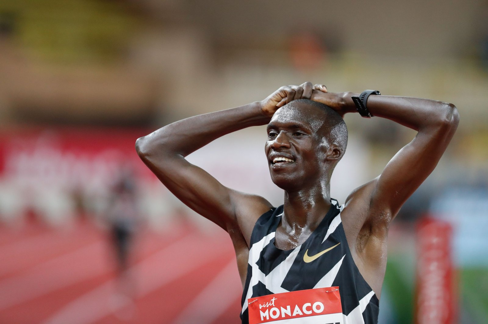 Uganda's Joshua Cheptegei celebrates after winning and breaking the world record in the men's 5000metre event during the Diamond League Athletics Meeting at The Louis II Stadium in Monaco on August 14, 2020. (AFP Photo)