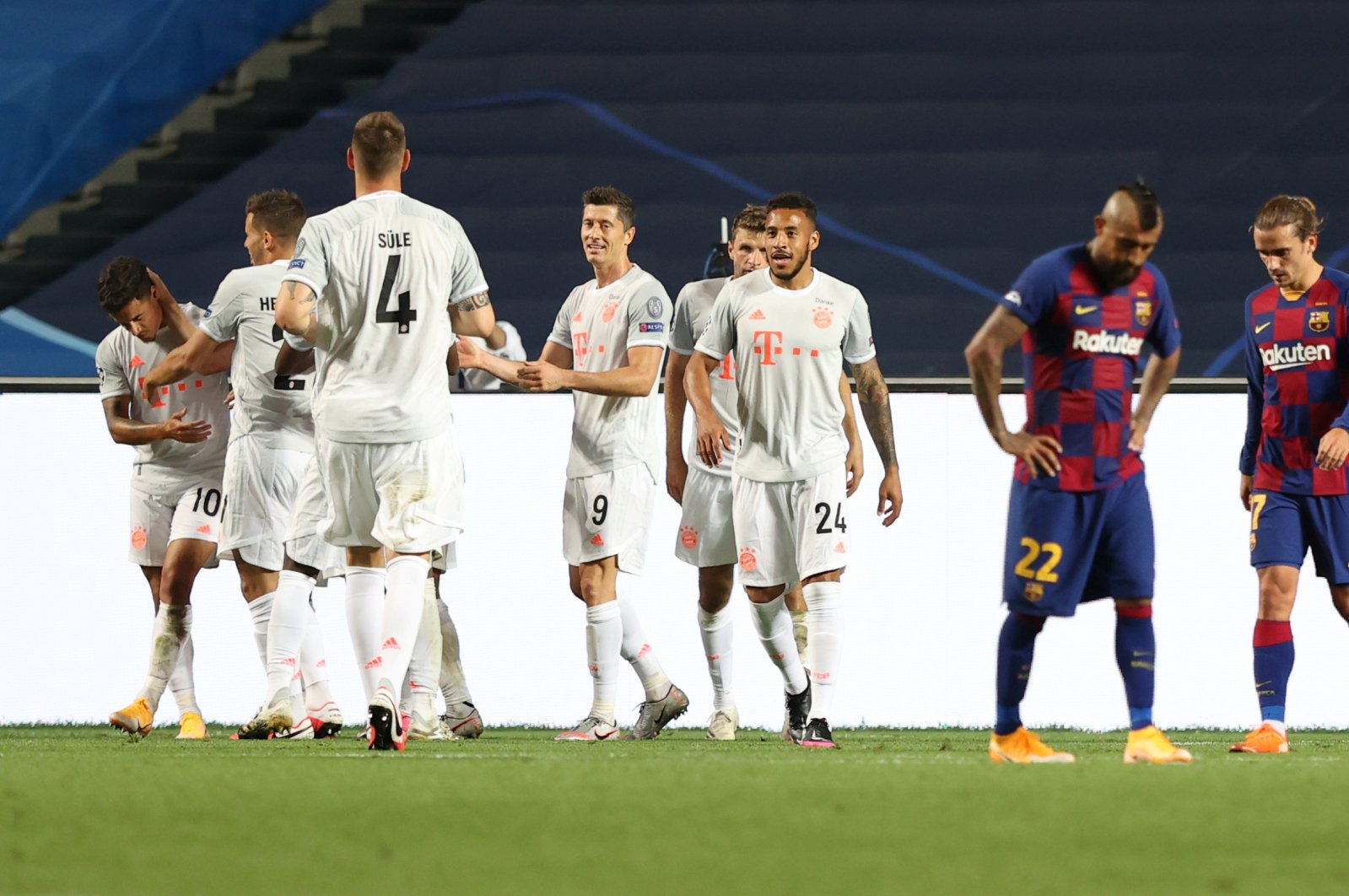 Bayern Munich's Philippe Coutinho celebrates scoring his team's seventh goal with teammates during a Champions League quarterfinal match against Barcelona in Lisbon, Portugal, Aug. 14, 2020. (Reuters Photo)