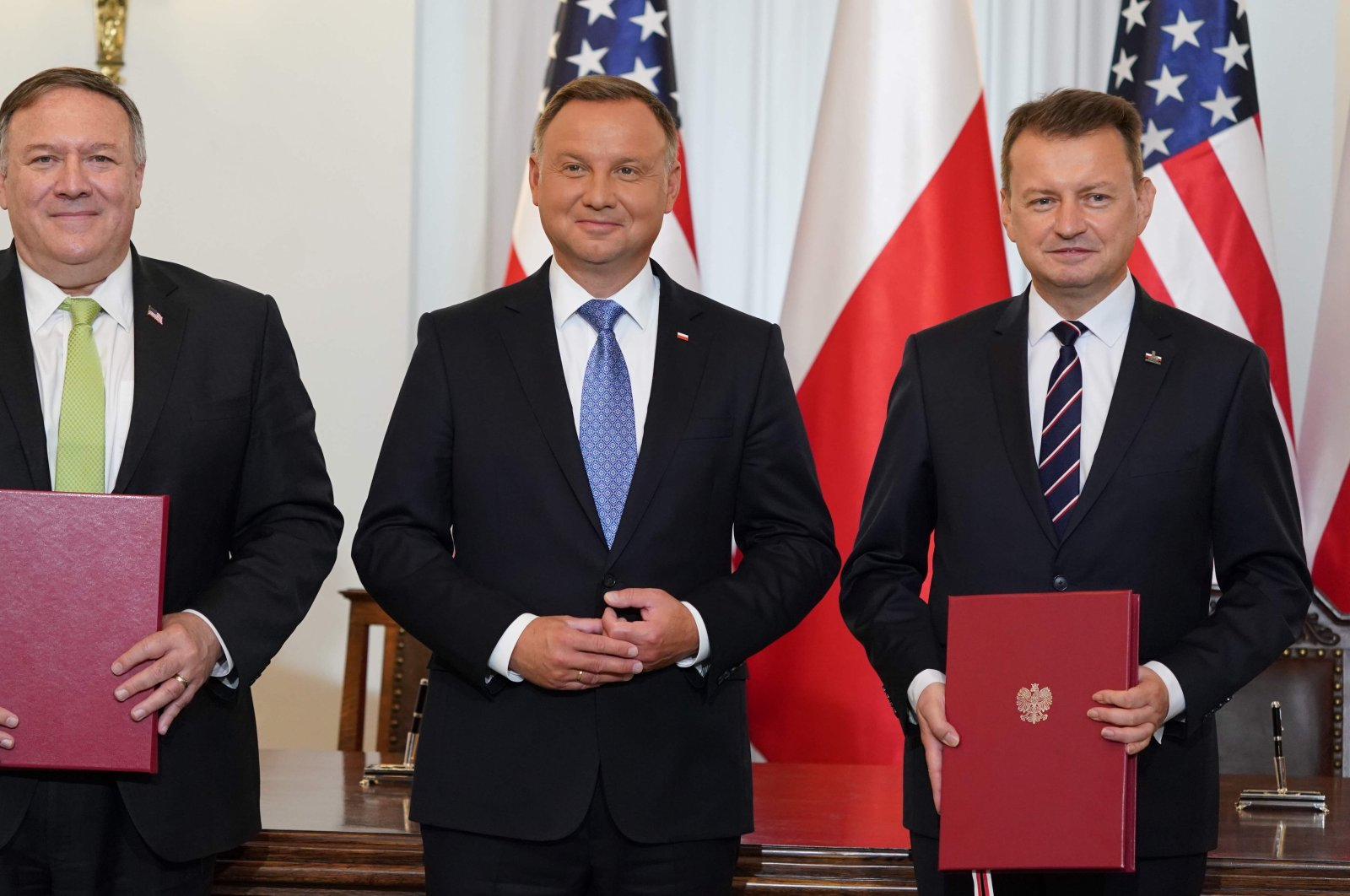 (L-R) US Secretary of State Mike Pompeo, Polish President Andrzej Duda and Polish Minister of Defence Mariusz Blaszczak pose for a picture after they signed the US-Poland Enhanced Defence Cooperation Agreement in the Presidential Palace in Warsaw, Poland, on August 15, 2020. (AFP Photo)