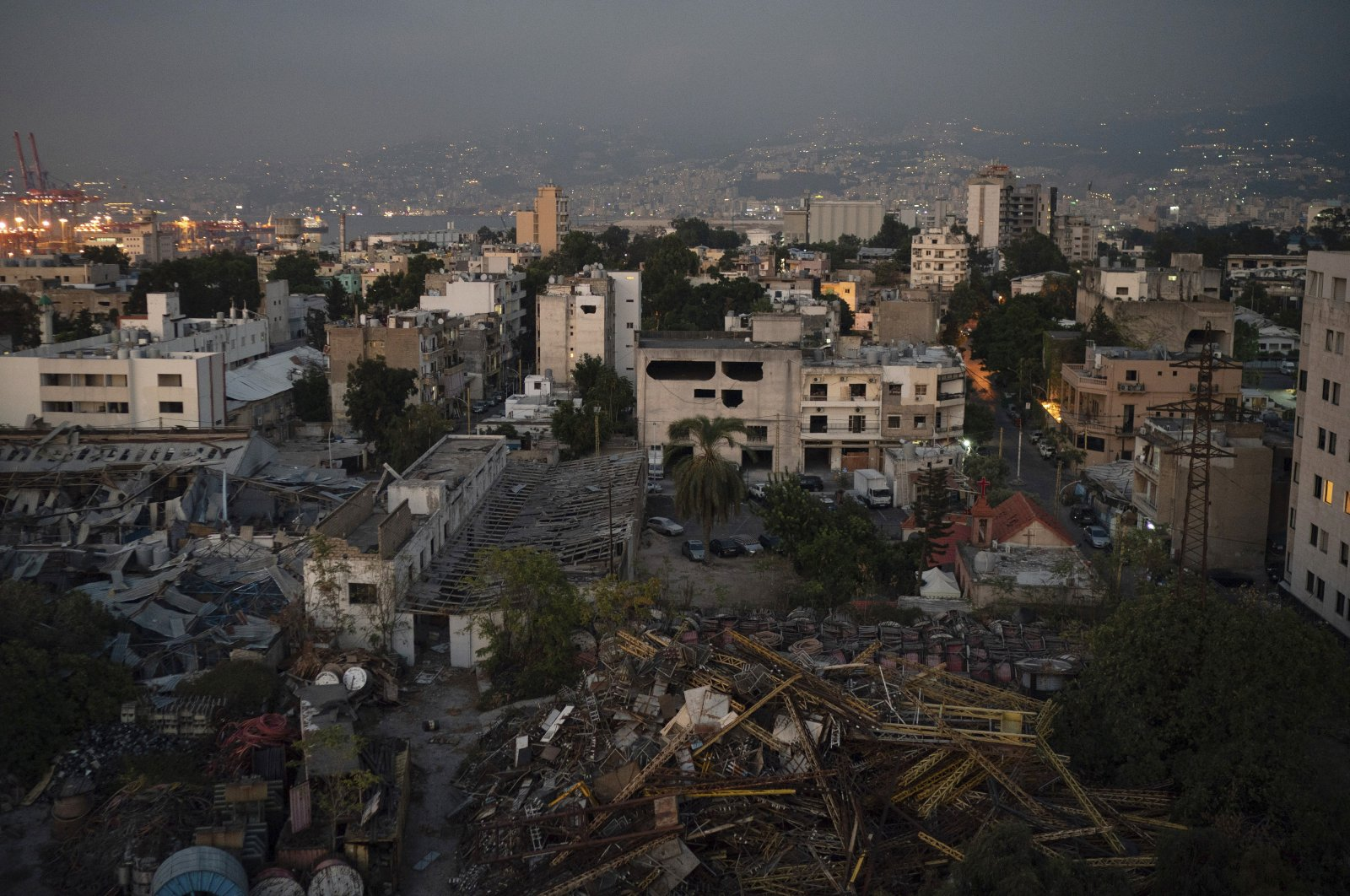 Damaged buildings are seen near the site of last week's massive explosion in the port of Beirut, Lebanon, Friday, Aug. 14, 2020. (AP Photo)