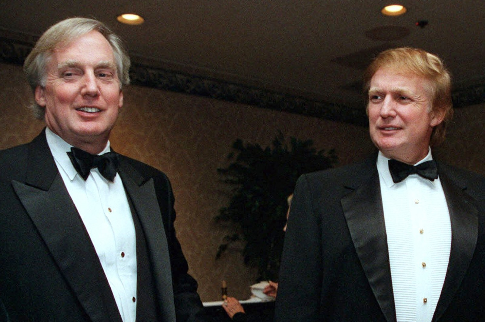 In this file photo, Robert Trump (L), joins then real estate developer and presidential hopeful Donald Trump at an event in New York, Nov. 3, 1999. (AP File Photo)