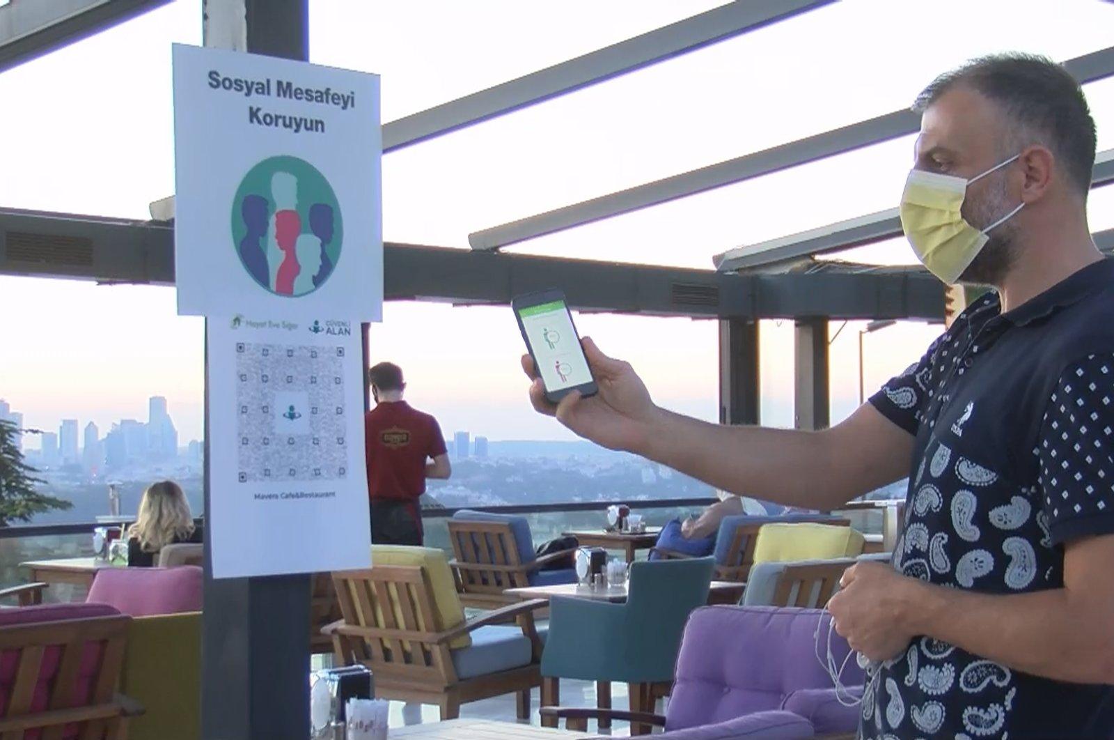 A customer scans a QR code via app at a restaurant, in Istanbul, Turkey, Aug. 16, 2020. (DHA Photo)