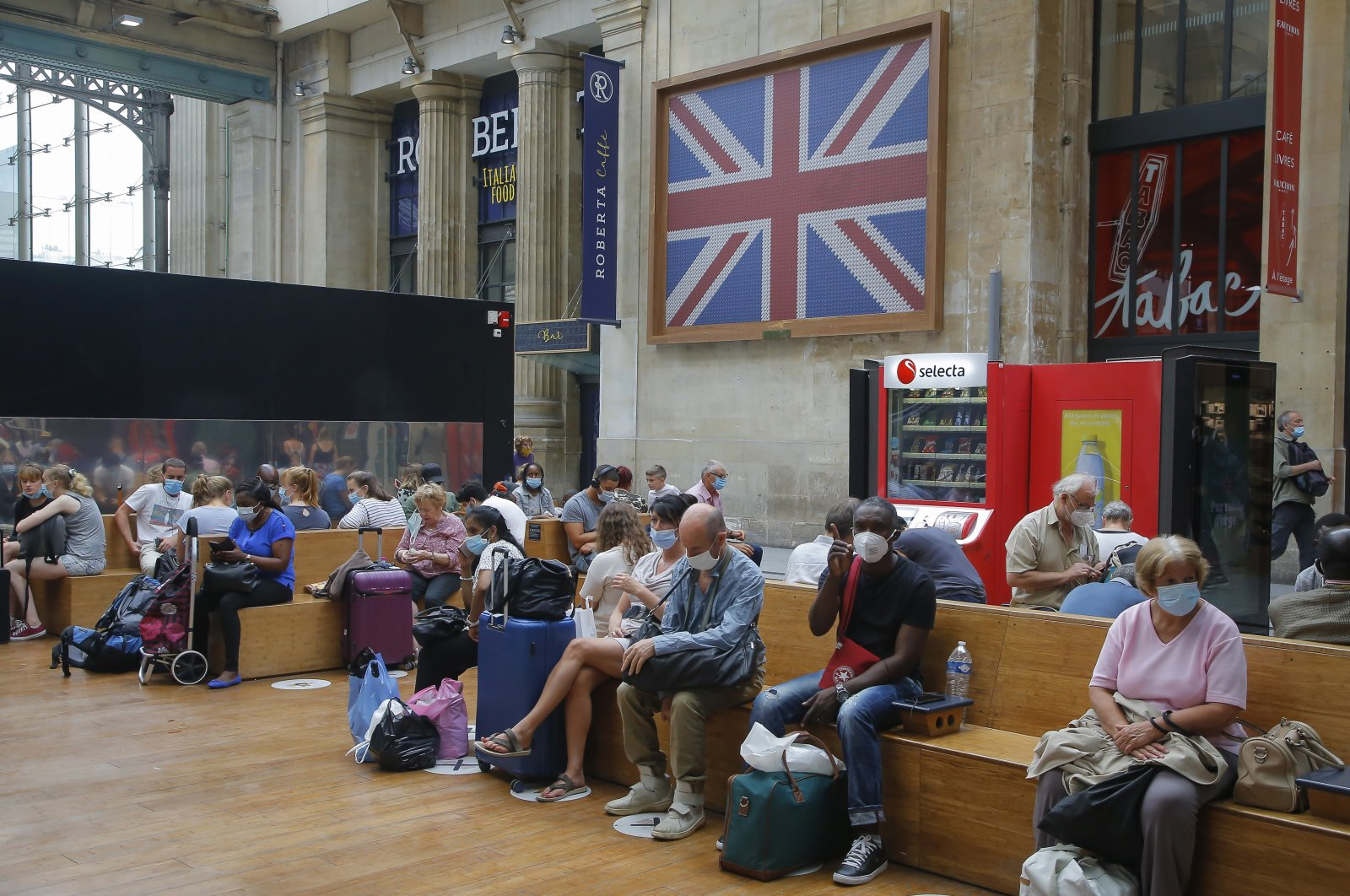Passengers wait next to the Eurostar Terminal at the Gare du Nord train station, Paris, Aug. 14, 2020. (AP Photo)