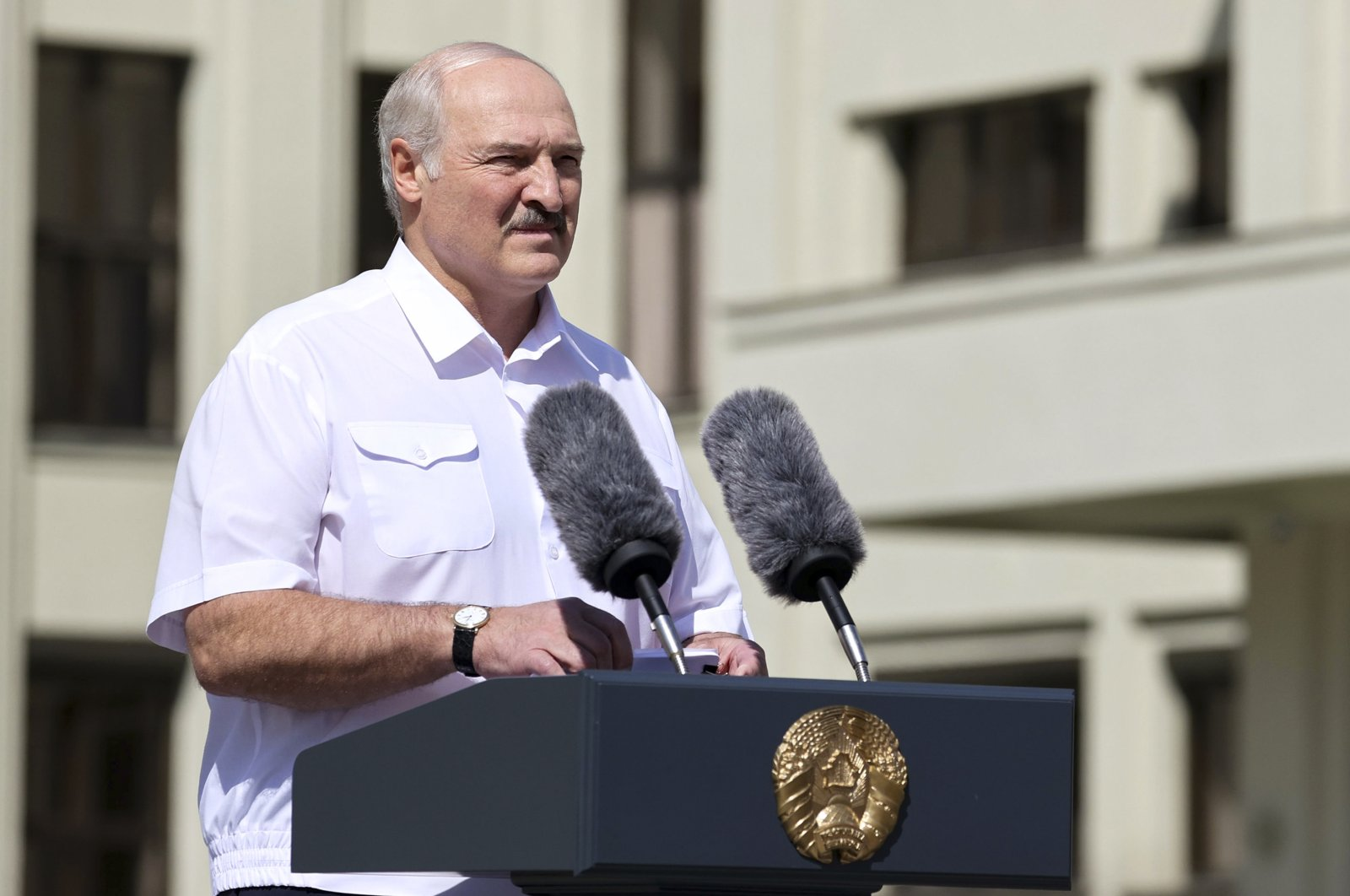 Belarusian President Alexander Lukashenko addresses people gathered at the Independent Square in Minsk, Aug. 16, 2020. (AP Photo)