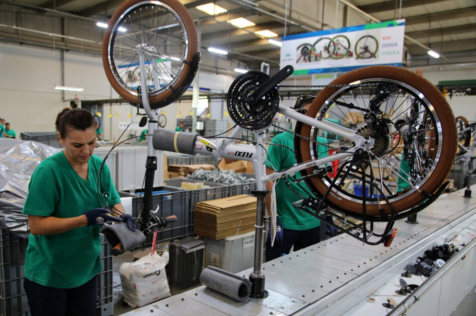 Workers are seen at a factory manufacturing bicycles in Turkey's western province of Manisa, Sept. 23, 2019. (AA Photo)