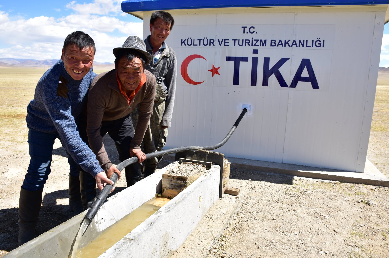 Locals stand by a water well built by TİKA in Bayankhongor, Mongolia, June 17, 2020. (AA Photo)