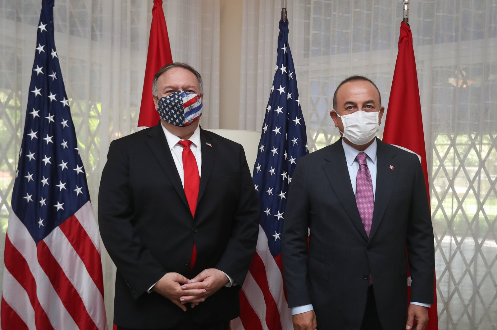 Foreign Minister Mevlüt Çavuşoğlu (R) and U.S. Secretary of State Mike Pompeo pose at a meeting in Santo Domingo, Dominican Republic, Aug. 16, 2020. (AA Photo)