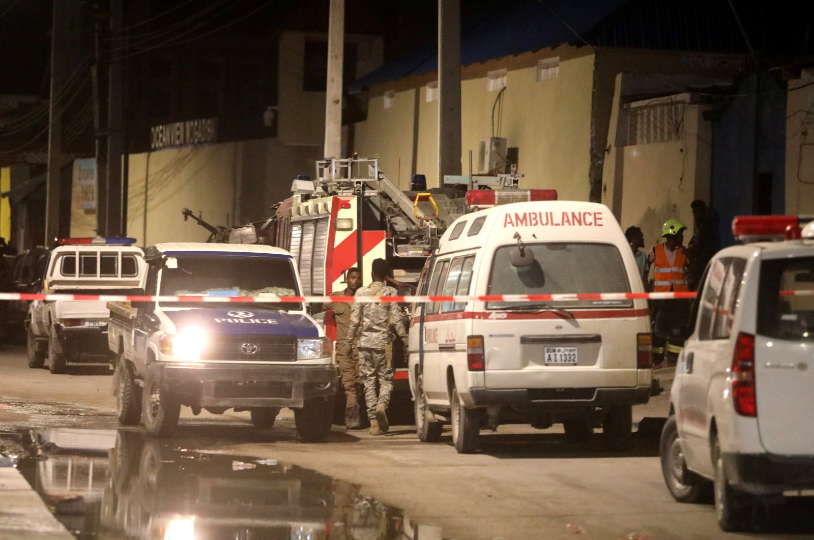 Emergency vehicles are seen at a cordoned off area near the site of a blast at the Elite Hotel in Lido beach in Mogadishu, Somalia August 16, 2020. (Reuters Photo)