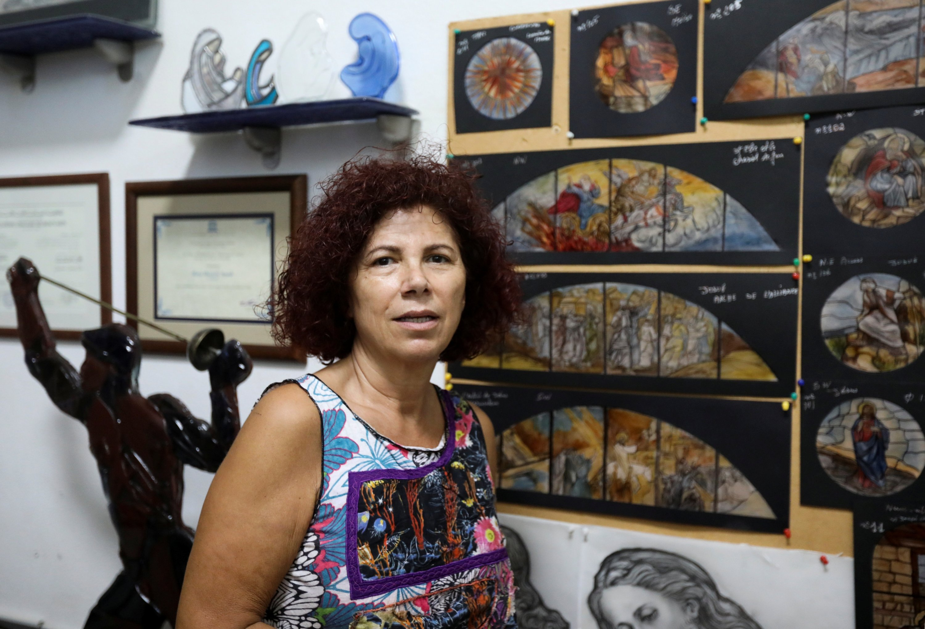 Stained glass maker Maya Husseini poses inside her workshop in Hazmiyeh, Lebanon on Aug. 13, 2020. (Reuters Photo)