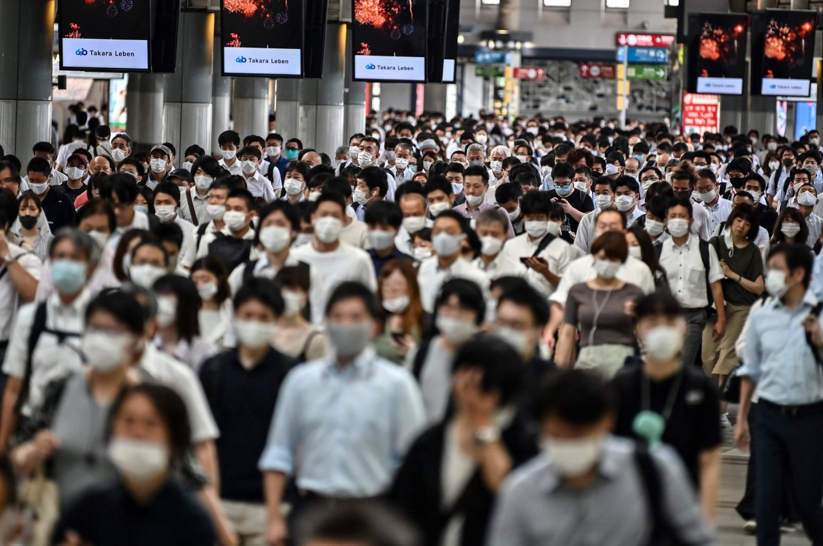 People commute on an early morning in Tokyo, Japan, Aug. 17, 2020. (AFP Photo)