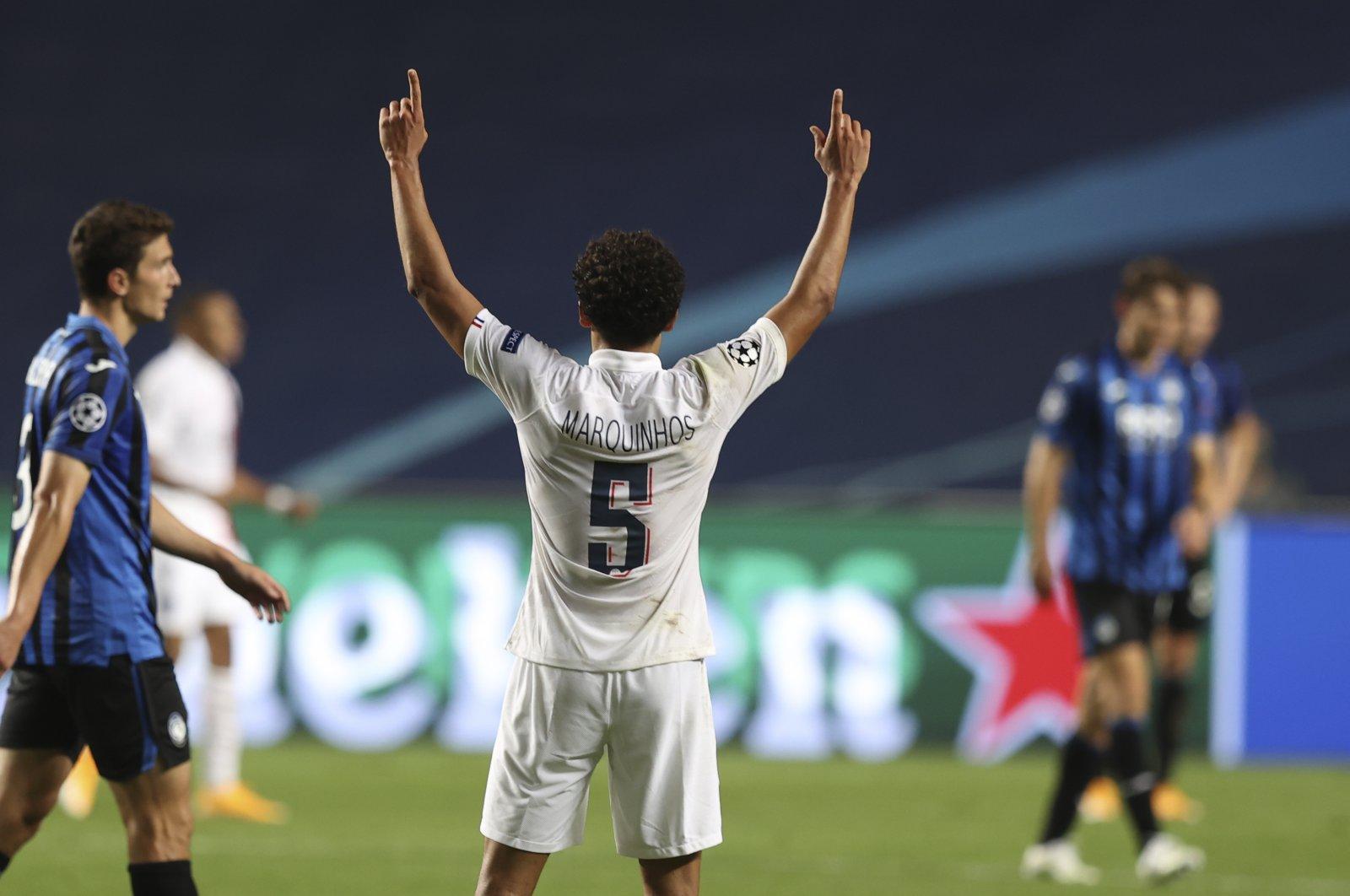 PSG's Marquinhos celebrates after the Champions League quarterfinal match against Atalanta, in Lisbon, Portugal, Aug. 12, 2020. (AP Photo)