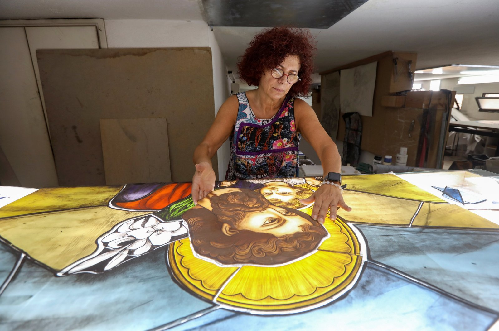 Stained glass maker Maya Husseini works inside her workshop in Hazmiyeh, Lebanon on Aug. 13, 2020. (Reuters Photo)