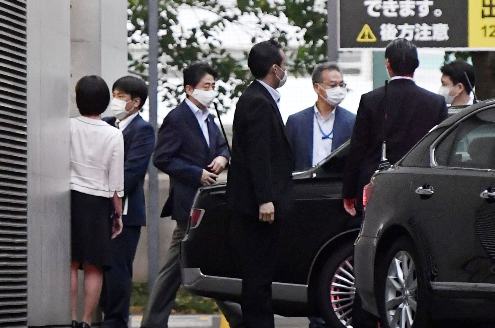 Japanese Prime Minister Shinzo Abe gets into a car as he leaves from Keio University Hospital in Tokyo, Japan, in this photo taken by Kyodo, August 17, 2020. (Kyodo Photo via Reuters)