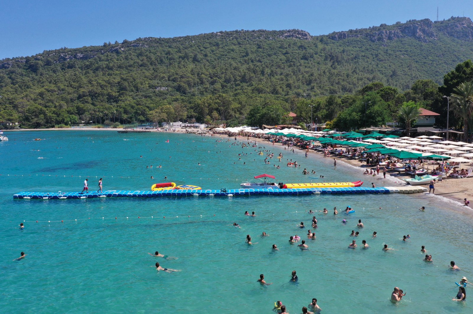 Holidaymakers enjoy the sea, sun and sand at a beach at the seaside resort town of Kemer in Antalya province on Turkey's southern Mediterranean coast in this undated photo. (DHA Photo)