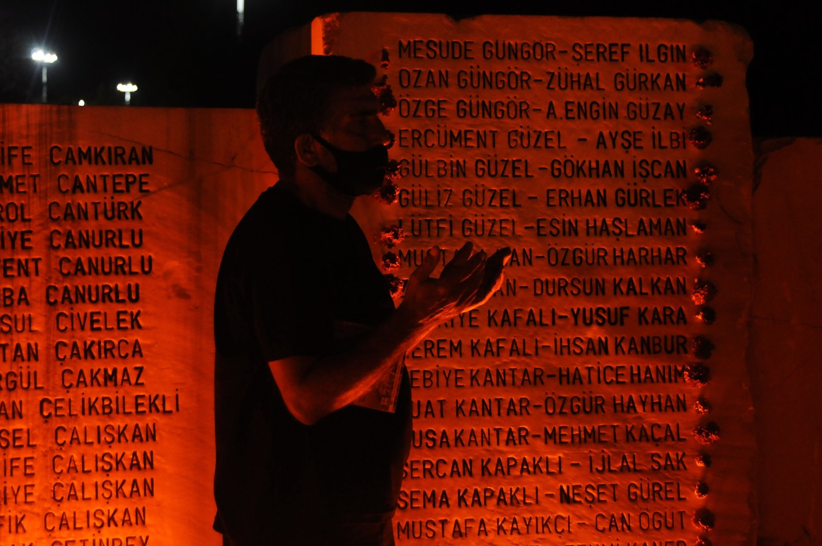 A man prays by a monument bearing names of earthquake victims, in Yalova, northwestern Turkey, Aug. 17, 2020. (AA Photo)
