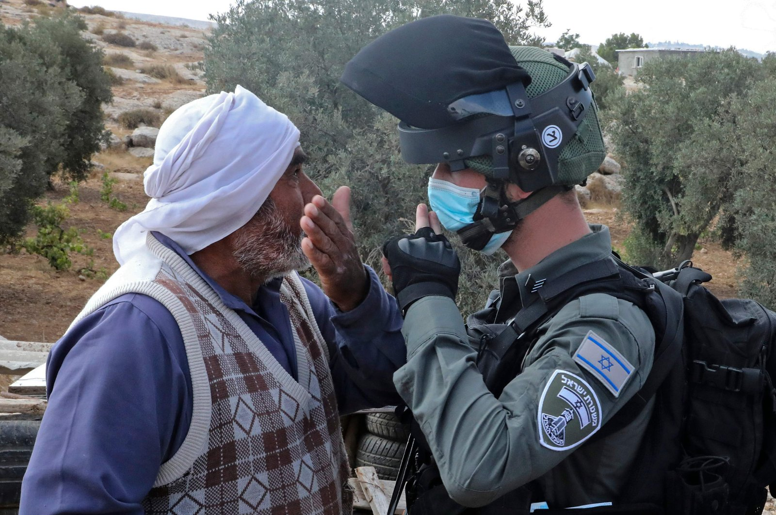 Protestors confront Israeli forces as a structure serving as a home to a Palestinian family is demolished in the village of Susya south Yatta in the southern West Bank, Aug. 11, 2020. (AFP Photo)