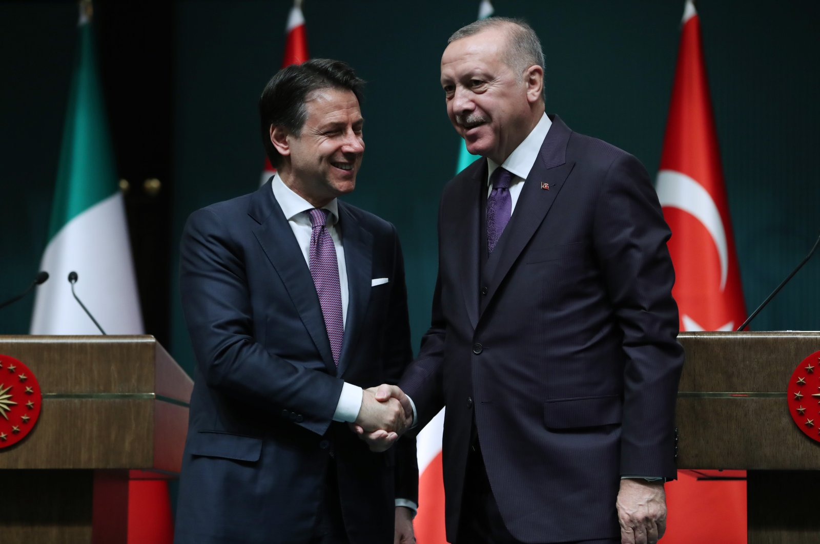 President Recep Tayyip Erdoğan shakes hand with Italian Prime Minister Giuseppe Conte in Ankara, Jan. 14, 2020. (AA Photo)