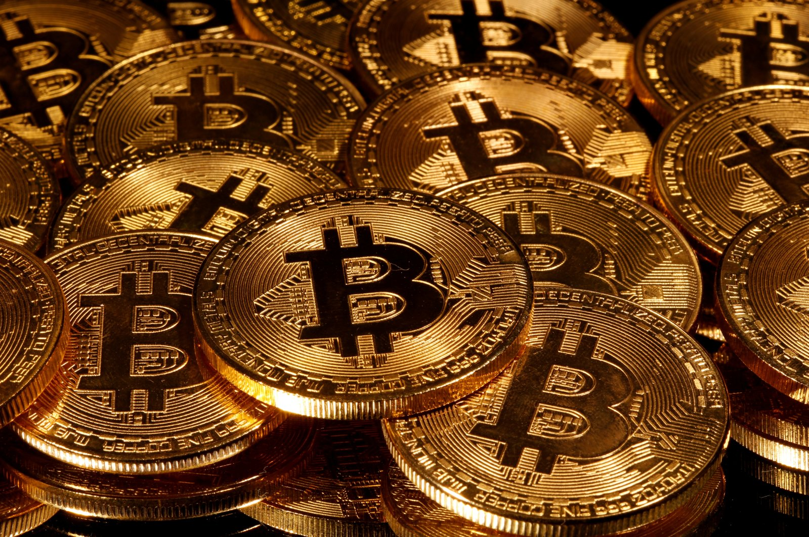 Representations of the virtual currency Bitcoin are seen in this picture illustration taken March 13, 2020. (Reuters Photo)