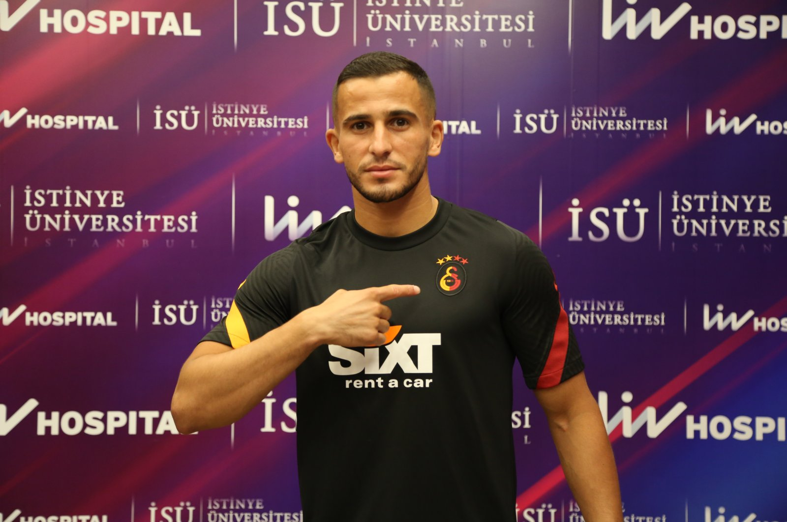 Omar Elabdellaoui poses with Galatasaray jersey after the signing in Istanbul, Turkey, Aug. 17, 2020. (AA Photo)