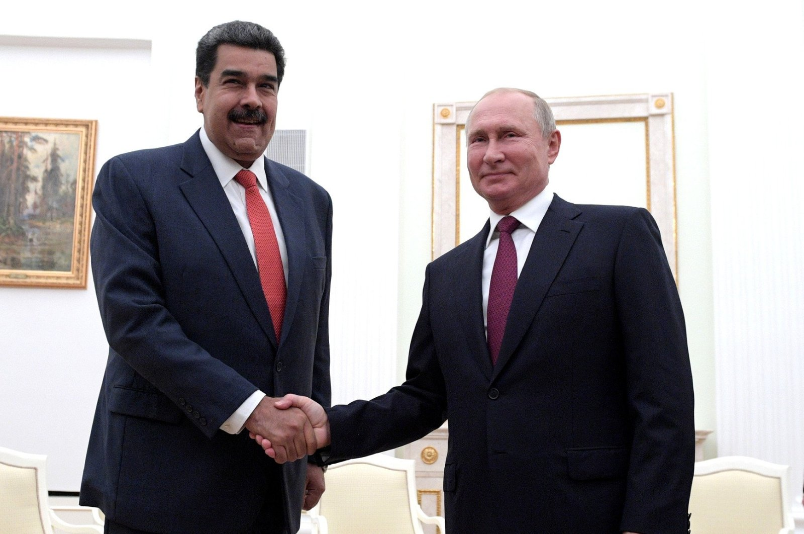 Venezuelan President Nicolas Maduro (L) and his Russian counterpart Vladimir Putin shake hands as they meet in Moscow, Russia, Sept. 27, 2019