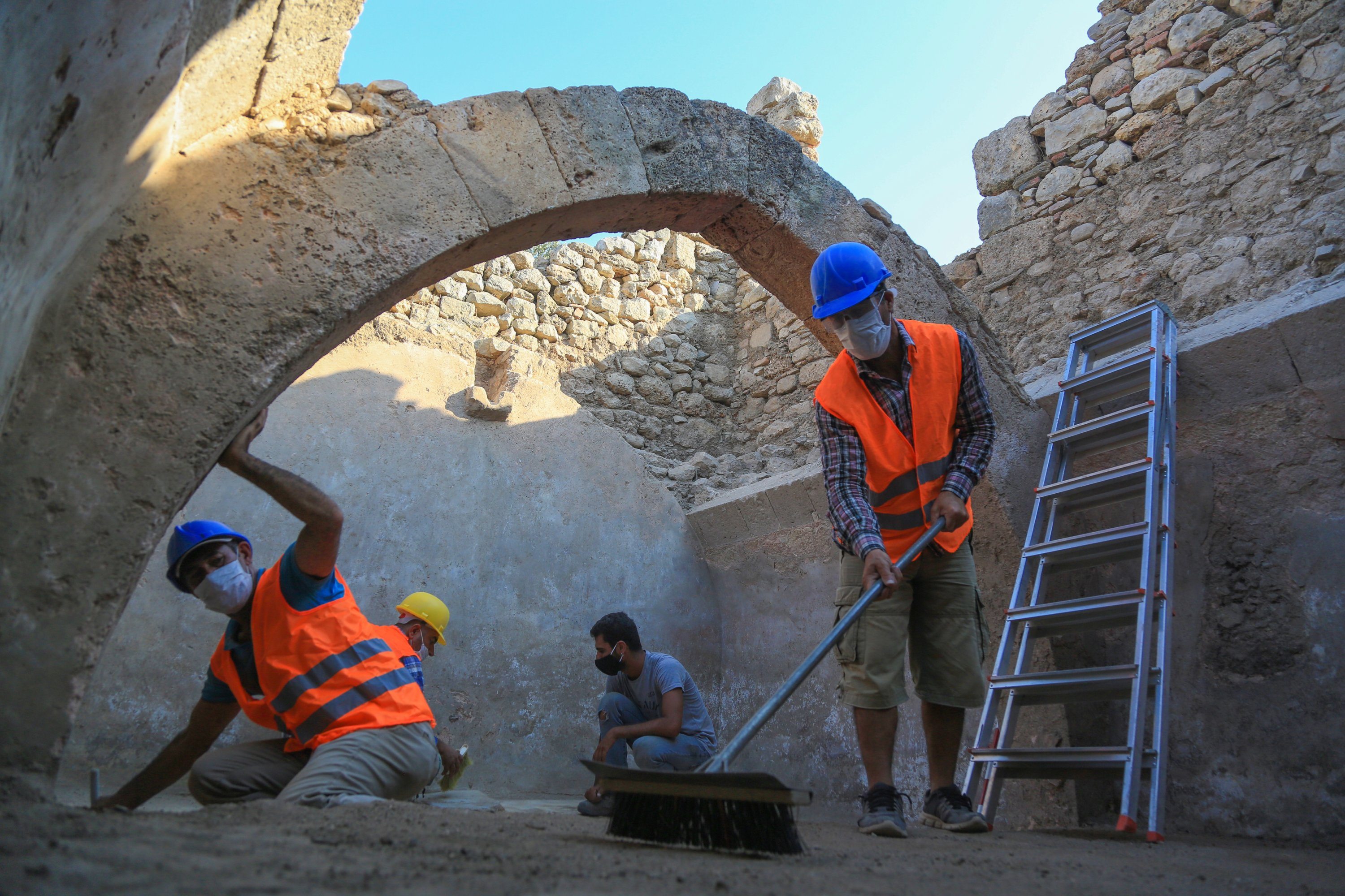 Officials work at the excavation of the cistern at the medieval city of Beçin, Muğla, southwestern Turkey, Aug. 17, 2020. (AA PHOTO)