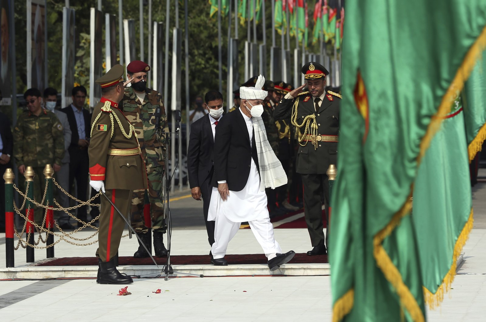 Afghan President Ashraf Ghani leaves the Independence Day celebrations at the Defense Ministry in Kabul, Afghanistan, Tuesday, Aug. 18, 2020. (AP Photo)