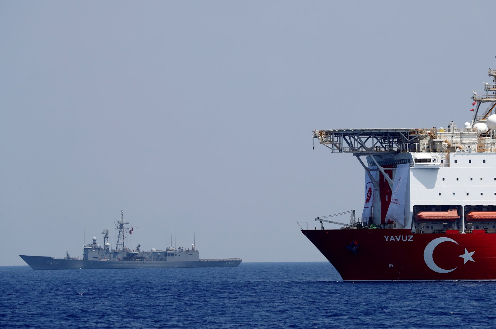 The Turkish drilling vessel Yavuz (R) being escorted by a Turkish navy frigate in the Eastern Mediterranean off the island of Cyprus, Aug. 6, 2019. (Reuters Photo)