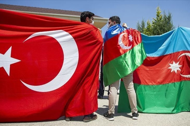 Two young men are seen side by side with the flags of Turkey and Azerbaijan as a symbol of the solidarity between the two countries, in this photo provided on Aug. 17, 2020. (AA PHOTO)