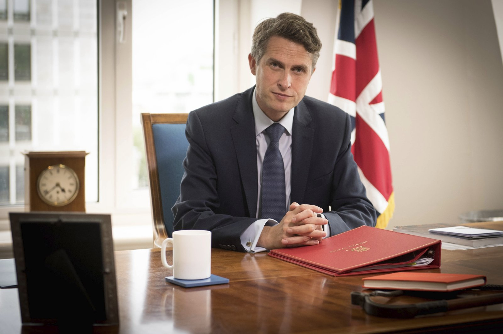 Britain's Secretary of State for Education Gavin Williamson poses for a photo in his office at the Department of Education in London, following the announcement that A-level and GCSE school results in England will now be based on teachers' assessments of their students, Aug. 17, 2020. (AP Photo)