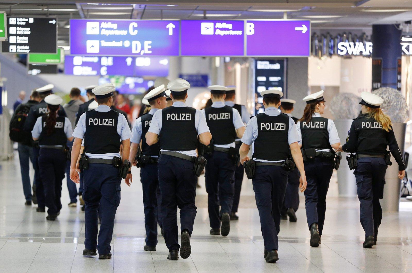 German police officers walk in an airport terminal, Frankfurt, March 23, 2016. (AP Photo)