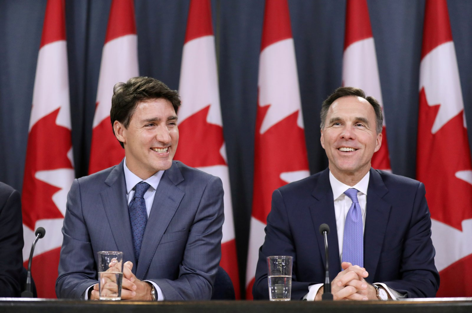 Canada's Prime Minister Justin Trudeau and Finance Minister Bill Morneau react during a news conference, Ottawa, Ontario, June 18, 2019. (REUTERS Photo)