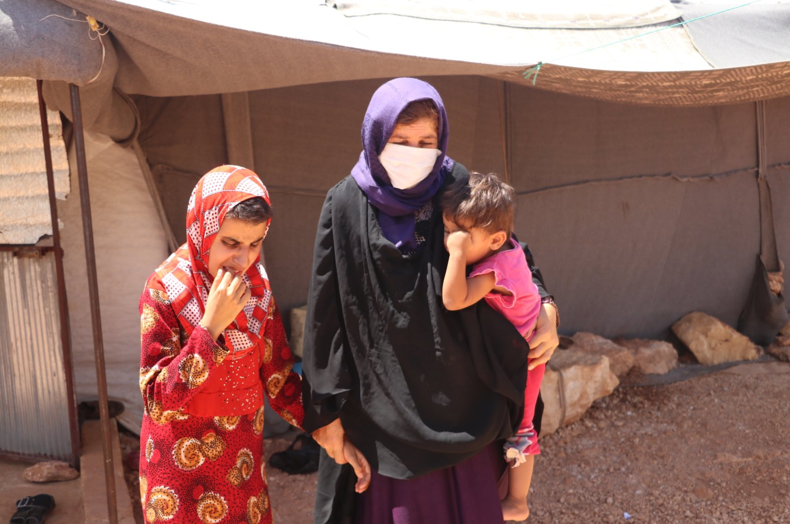 Displaced Syrian mother Gulsum al-Musa with two of her blind children, Idlib, Aug.18, 2020. (AA)